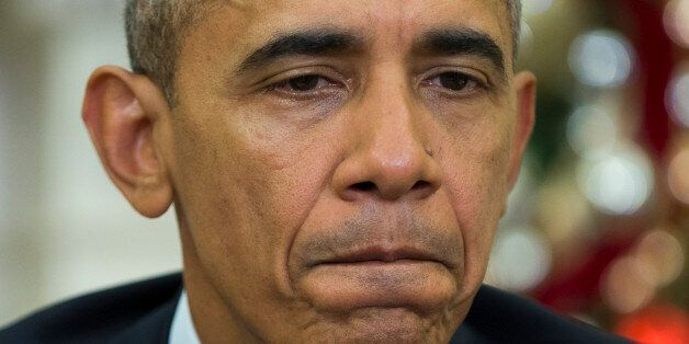 President Barack Obama pauses while making a statement on Wednesday's mass shooting in San Bernardino,...