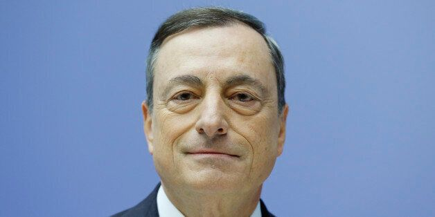 The President of the European Central Bank Mario Draghi waits for the beginning of a news conference...