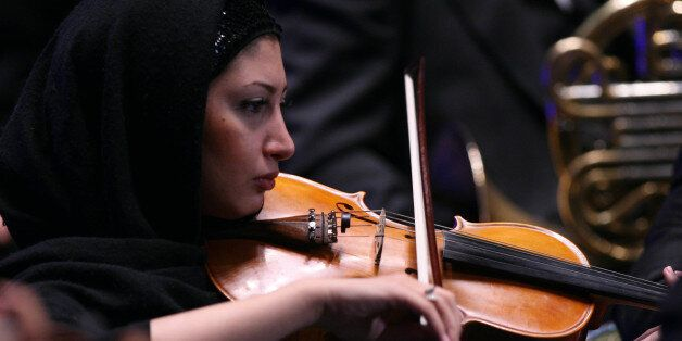 A member of Tehran Symphony Orchestra plays during Asian Mayors Forum in Tehran on Wednesday Oct, 19,...