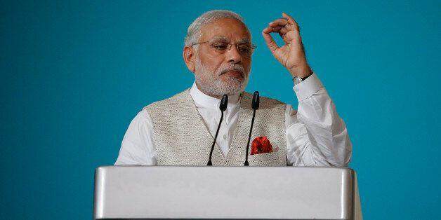 Indian Prime Minister Narendra Modi delivers the 37th Singapore Lecture Monday, Nov. 23, 2015, in Singapore...