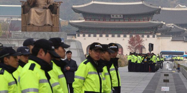 South Korean police officers stand guard near the Japanese Embassy for possible illegal protests against...
