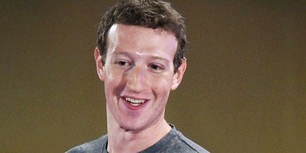 Facebook CEO Mark Zuckerberg interacts with technology students in a town hall-style meeting in New Delhi,...