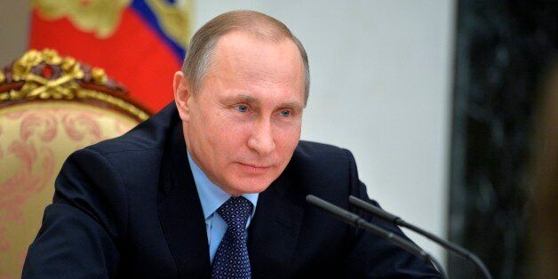 Russian President Vladimir Putin heads a cabinet meeting in the Kremlin in Moscow, Russia, Wednesday,...