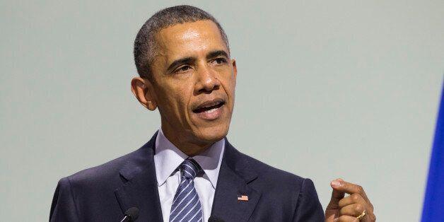 U.S. President Barack Obama delivers remarks during the COP21, United Nations Climate Change Conference,...