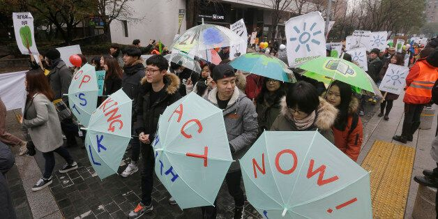 Environmental activists march during the Global Climate March in Seoul, South Korea, Sunday, Nov. 29,...
