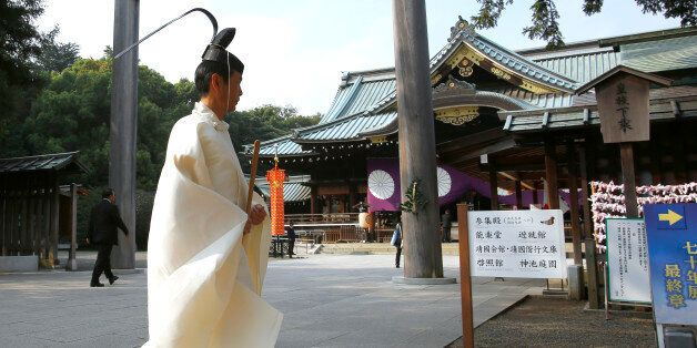A Shinto priest walks in front of the main shrine during the four-day annual Autumn Festival in the compound...