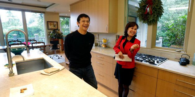 Janie Lee, right, a residential specialist with John L. Scott Real Estate, shares a laugh in the kitchen...