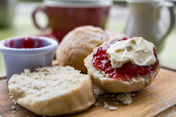 English Cream tea with scones jam and clotted cream and cup of tea