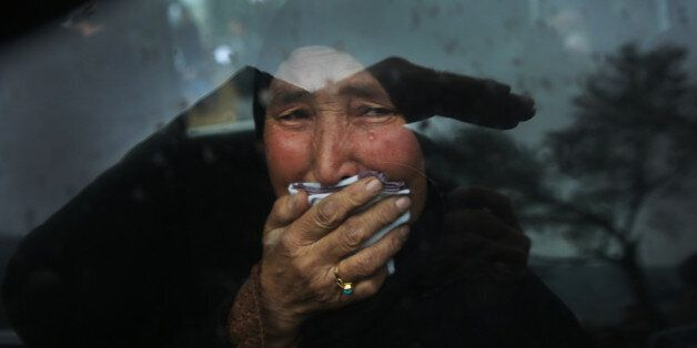 A Hazara tribeswoman cries in a car as thousands march through the Afghan capital of Kabul on Wednesday,...