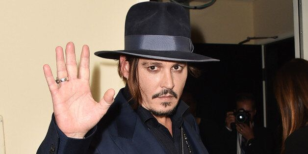 Johnny Depp poses in the press room at the Hollywood Film Awards at the Beverly Hilton Hotel on Sunday,...