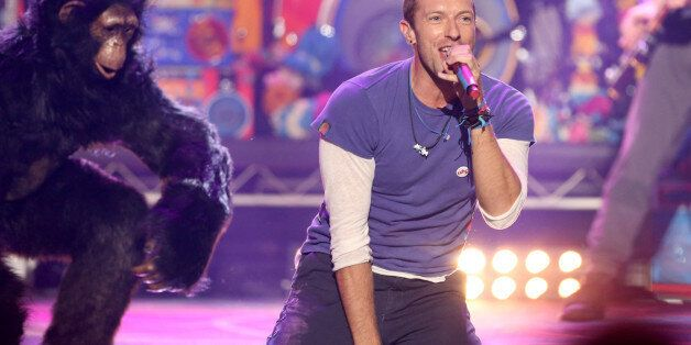 Chris Martin of Coldplay performs at the American Music Awards at the Microsoft Theater on Sunday, Nov....