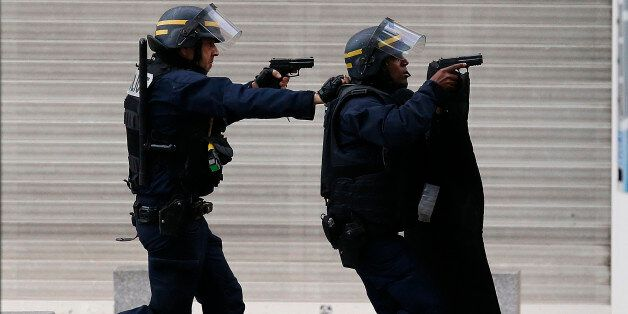 Armed police operate in Saint-Denis, a northern suburb of Paris, Wednesday, Nov. 18, 2015. Police say...