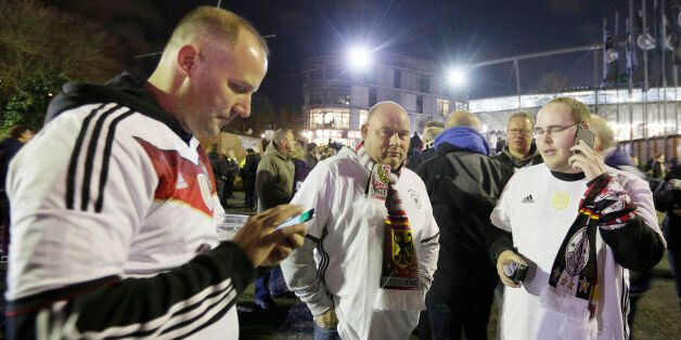 German soccer fans stand outside the stadium as the soccer friendly match between Germany and the Netherlands...