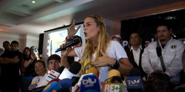 Lilian Tintori, center, wife of jailed opposition leader Leopoldo Lopez, speaks during a news conference...