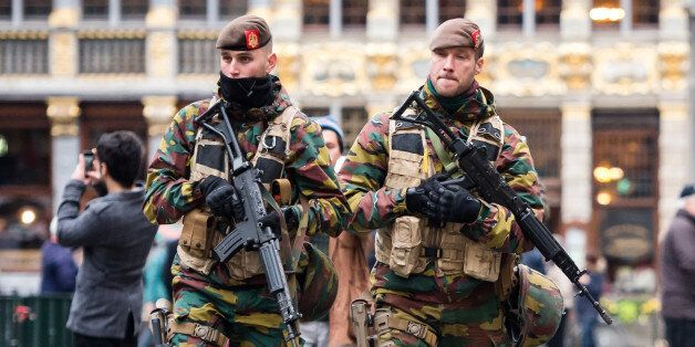 Belgian Army soldiers patrol in the picturesque Grand Place in the center of Brussels on Friday, Nov....