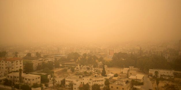 A sandstorm shrouds the Gaza strip, Tuesday, Sept. 8, 2015. An unseasonal sandstorm hit many countries...