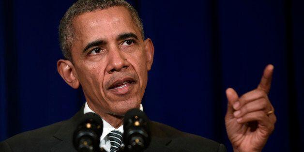 President Barack Obama speaks at a news conference in Kuala Lumpur, Malaysia, Sunday, Nov. 22, 2015....