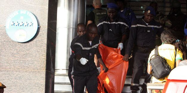 A body is removed from the Radisson Blu hotel, after it was stormed by gunmen during a attack on the...