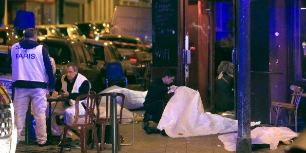RETRANSMISSION FOR ALTERNATIVE CROP - Victims lay on the pavement outside a Paris restaurant, Friday,...