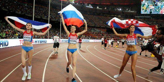 Russia's Maria Kuchina, center, Croatia's Blanka Vlasic, right, and Russia's Anna Chicherova celebrate...