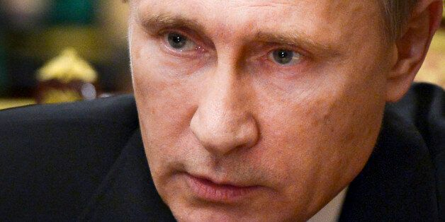 Russian President Vladimir Putin speaks as he heads a meeting on the Russian plane crash in Egypt, in...