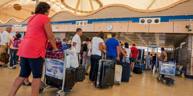 Passengers line up to depart from Sharm el-Sheikh Airport hours after a Russian aircraft carrying 224...