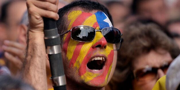 A supporter of the independence of the Catalonia region of Spain, with an estelada or pro independence...