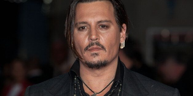 Actor Johnny Depp poses for photographers upon arrival at the Premiere of the film Black Mass, showing...