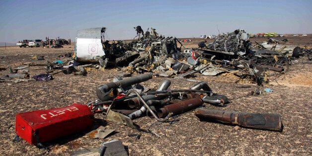 Egyptian security forces stand guard by debris of a Russian airplane at the site a day after the passenger...