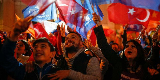 Supporters of Turkey's President Recep Tayyip Erdogan and The Justice and Development Party, (AKP), wave...