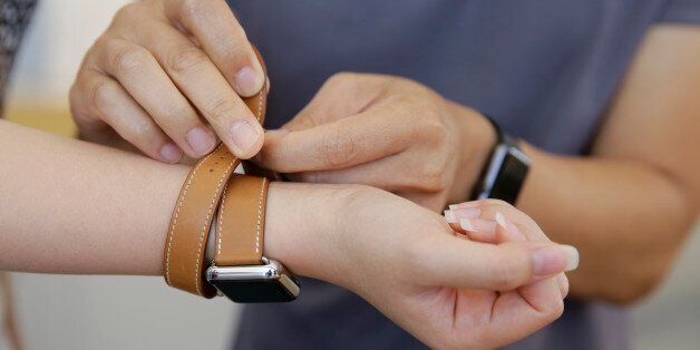 Letty Liang, of San Francisco, tries on the new Apple Watch Hermes at the Apple store Monday, Oct. 5,...
