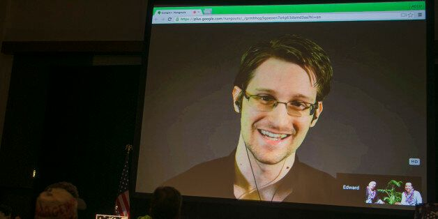 National Security Agency leaker Edward Snowden appears on a live video feed broadcast from Moscow at...