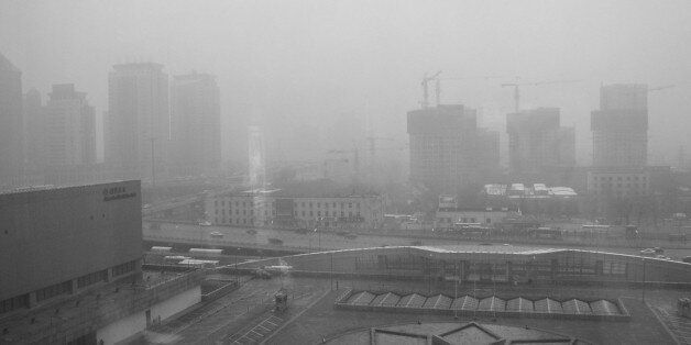 Beijing smog as seen from the China World Hotel, March 2003, during the SARS outbreak.This was my first...