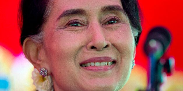 Myanmar's opposition leader Aung San Suu Kyi addresses the media at a press conference at her home in...