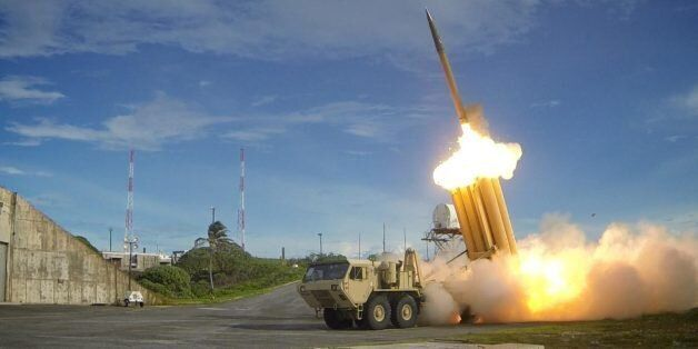 The first of two Terminal High Altitude Area Defense (THAAD) interceptors is launched during a successful...