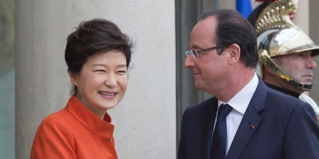 France's President Francois Hollande, right, poses for photographers with South Korean President Park...