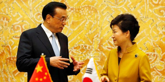South Korean President Park Geun-Hye, right, talks with Chinese Premier Li Keqiang during a signing agreement...
