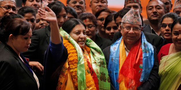 Bidhya Devi Bhandari of the Communist Party of Nepal Unified Marxist-Leninist waves her hand after she...
