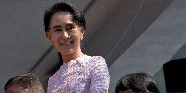 Myanmar's opposition leader Aung San Suu Kyi smiles after delivering a speech in Yangon, Myanmar, Monday,...