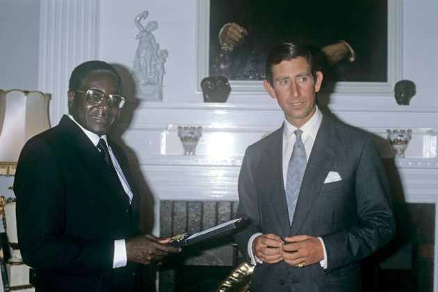 File photo dated 19/4/1980 of the Prince of Wales receiving an Independence Medal from Robert Mugabe,...