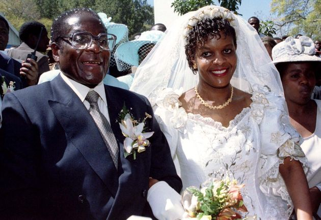 President Robert Mugabe and new wife Grace leave the Kutama Catholic Church August 17, 1996 after exchaning...