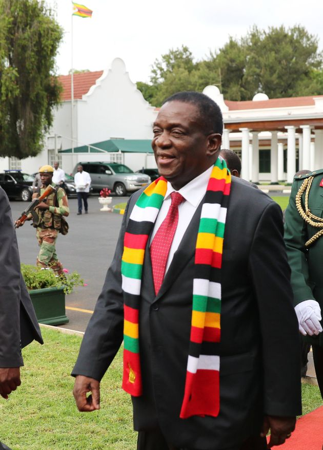 Zimbabwe's President Emmerson Mnangagwa arrives for talks with leaders of opposition parties in Harare,...