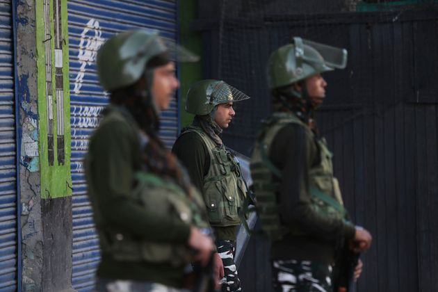 Indian paramilitary soldiers guard at a closed market in Srinagar, Kashmir, Wednesday, Aug. 21,