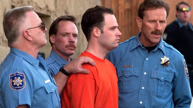 "Randy Halprin, 23, one of the ""Texas Seven"" prison escapees, is led out of the Teller County Courthouse after a extradition hearing in Cripple Creek, Colorado, January 26, 2001. Fellow escapee Joseph Garcia also appeared in court today.