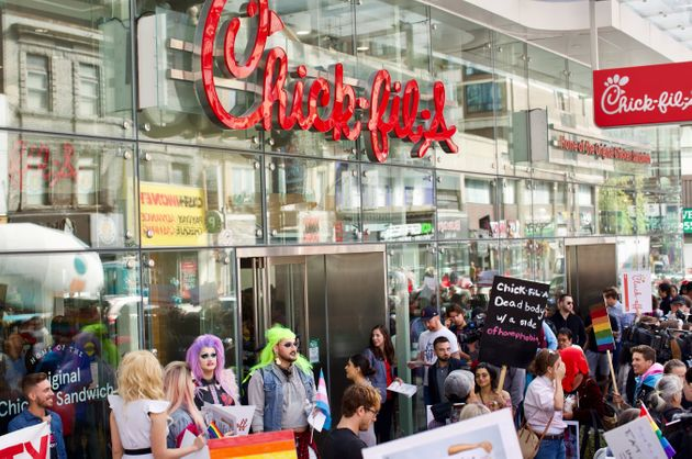 Protesters swarmed the area outside Chick-fil-A as customers lined up along Yonge St. for