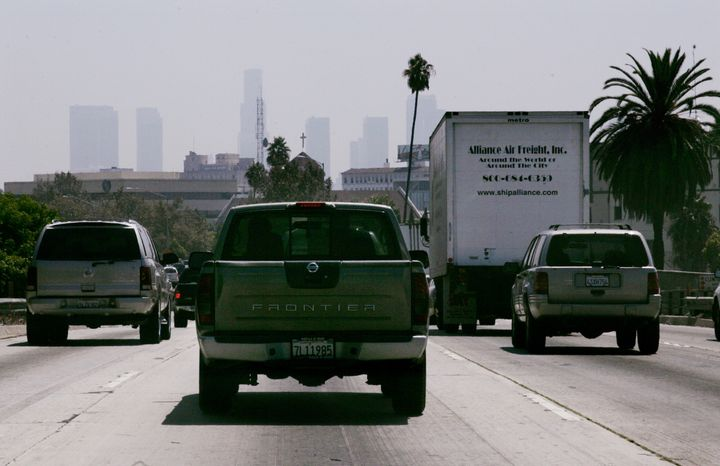 Cars and trucks travel on a freeway in Los Angeles. Advocates of the emissions agreement argue that it would signif