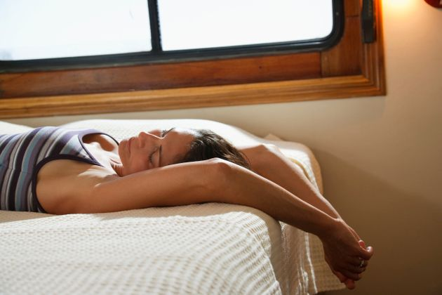 Woman relaxing in cruise ship cabin in the Isla San Marcos area of the Sea of Cortez, Baja California,