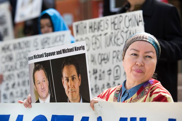Turnisa Matsedik-Qira, of the Vancouver Uyghur Association, holds a photo of detained Canadians Michael...