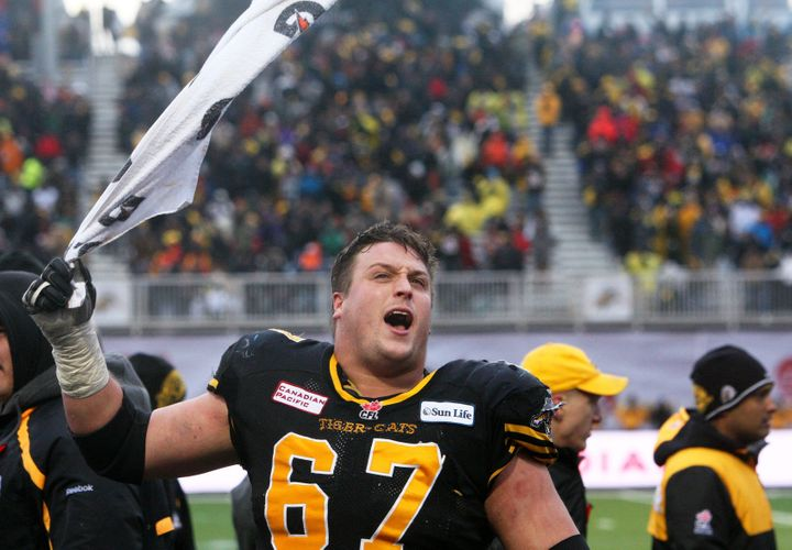 Peter Dyakowski gets the crowd going during the CFL Eastern semi-final in Guelph on Nov. 10, 2013.