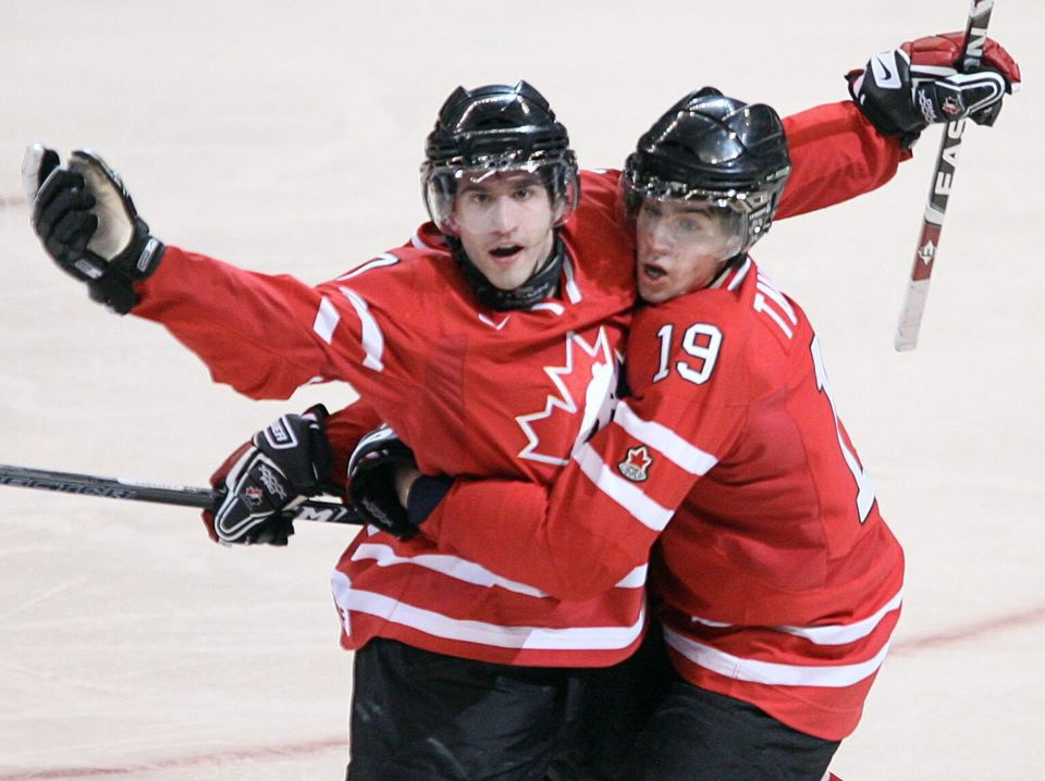 Angelo Esposito celebrates his goal with teammate John Tavares in the gold medal game at the World Junior...